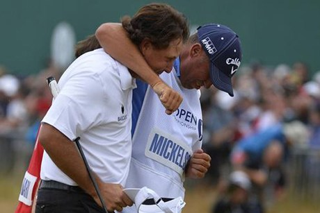 "Phil Mickelson celebrates with caddie Jim ""Bones"" Mackay (Reuters)"